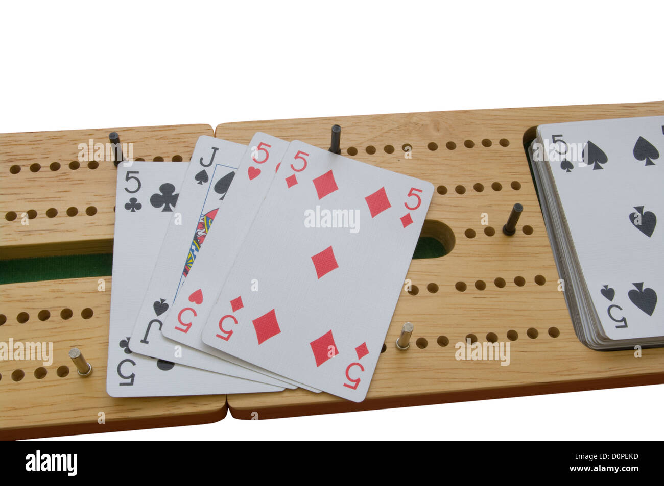 Cribbage Board and Playing Cards - Stock Image