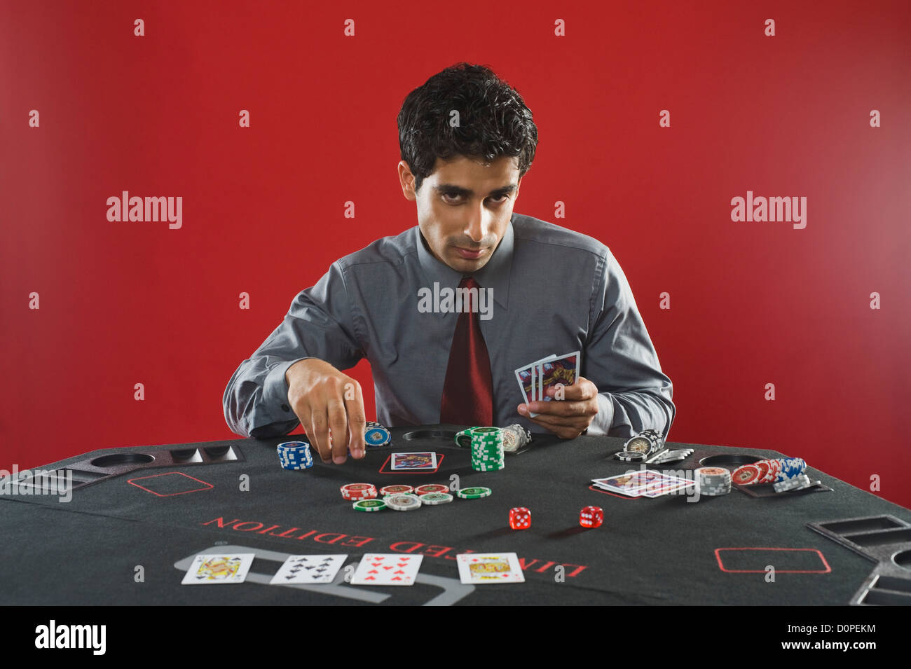 Portrait of a man gambling in a casino - Stock Image