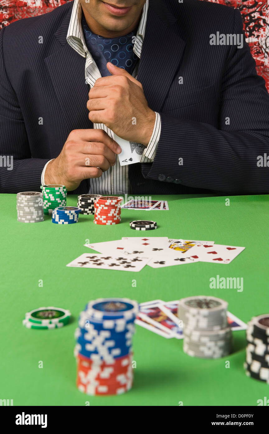 Man at a casino table - Stock Image