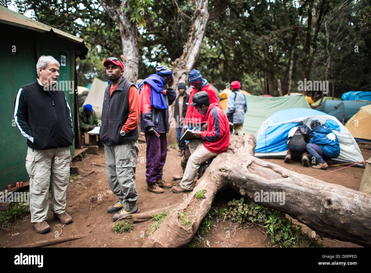 MT KILIMANJARO, Tanzania - Relaxing at Big Tree Camp (formally known as Forest Camp) on the first night of a climb - Stock Image