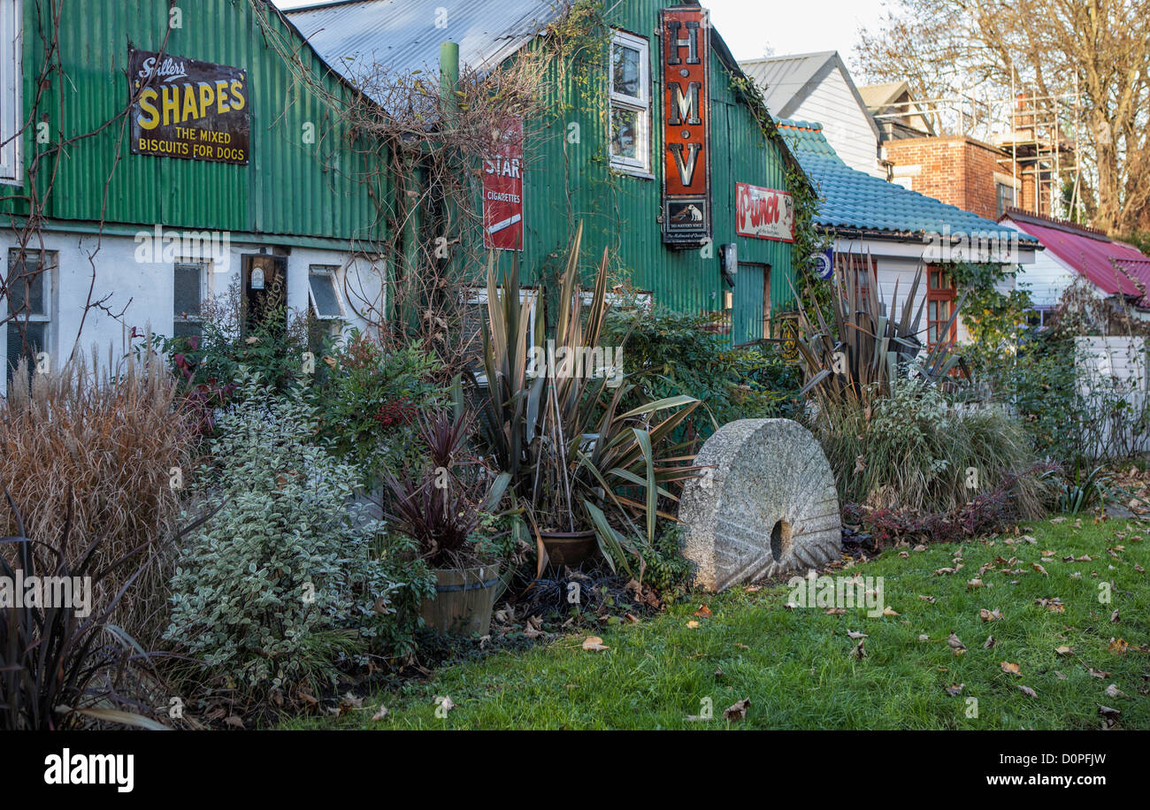 Corrugated iron building and old advertisements on Eel Pie island which is home to a creative community - Twickenham - Stock Image