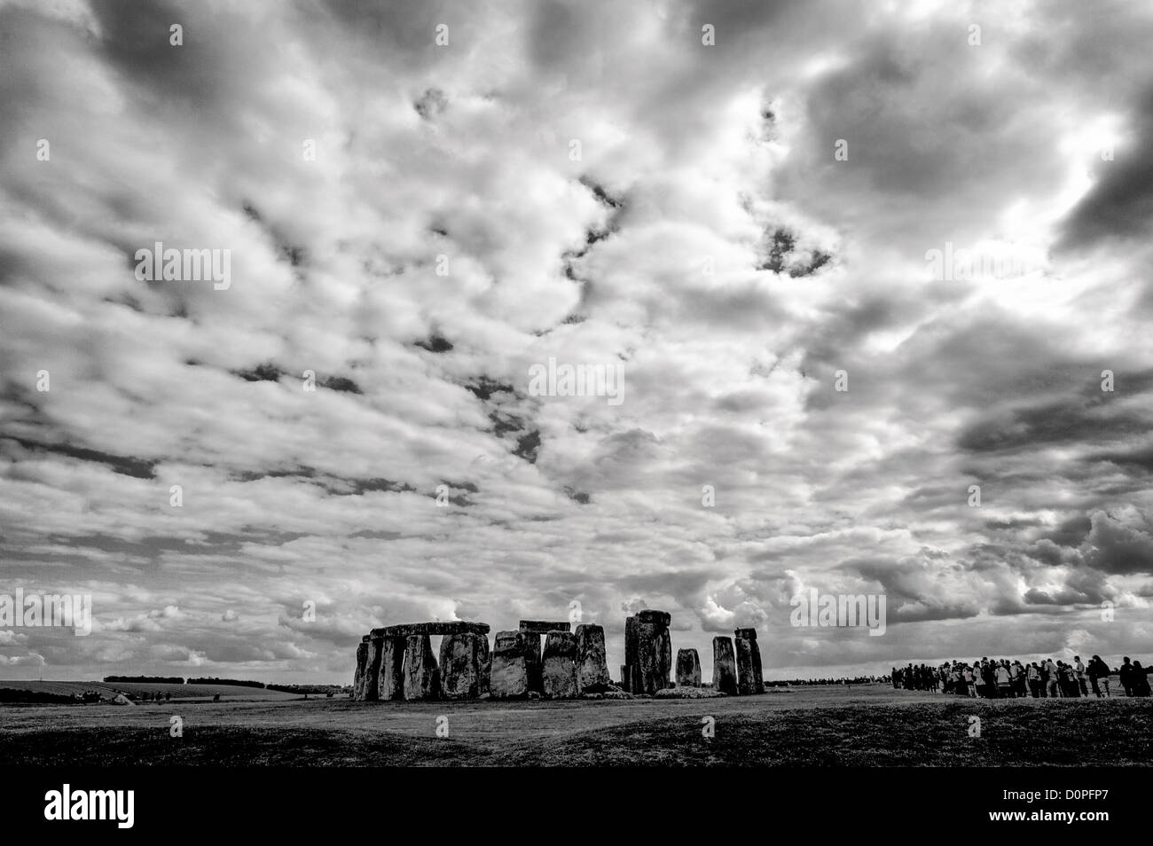 STONEHENGE, UK - LONDON, UK - Stonehenge Monochrome with Stark Clouds. Believed to have been built somewhere between Stock Photo