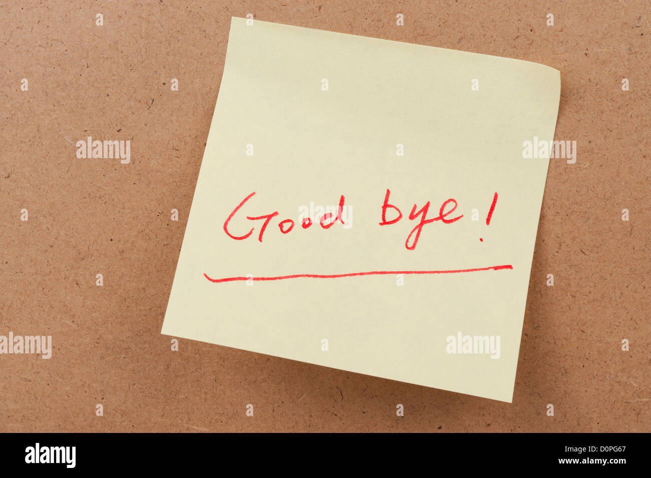 Good bye words written on sticky note and attached on the board - Stock Image