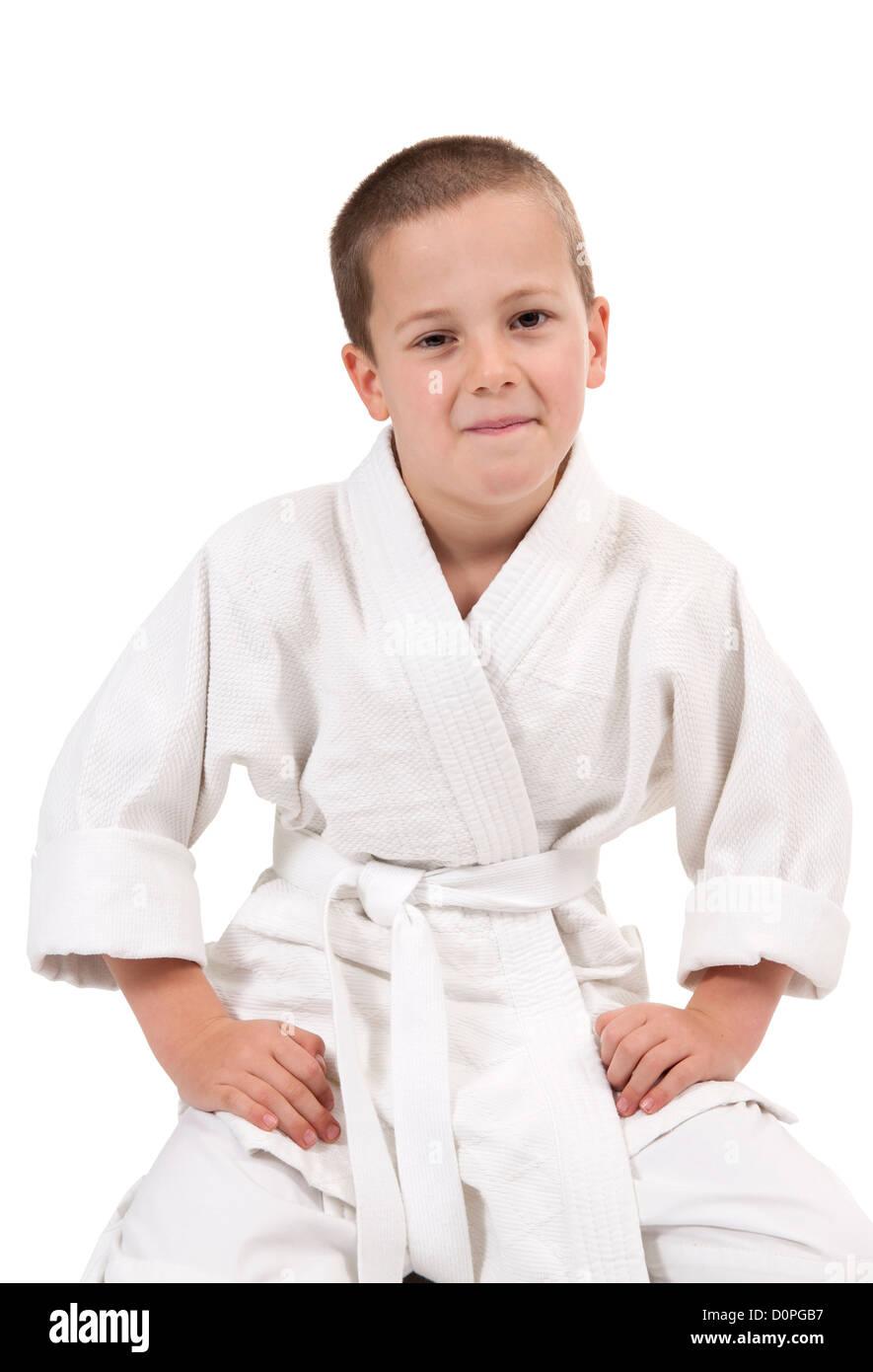 Karate kid in greeting stock photos karate kid in greeting stock seated boy in judo kimono isolated on white stock image m4hsunfo