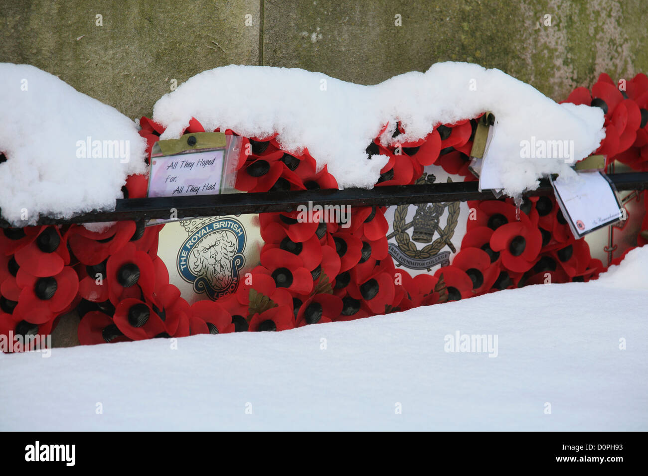 Rememberance Day poppy wreaths at Harrogate at cenotaph - Stock Image