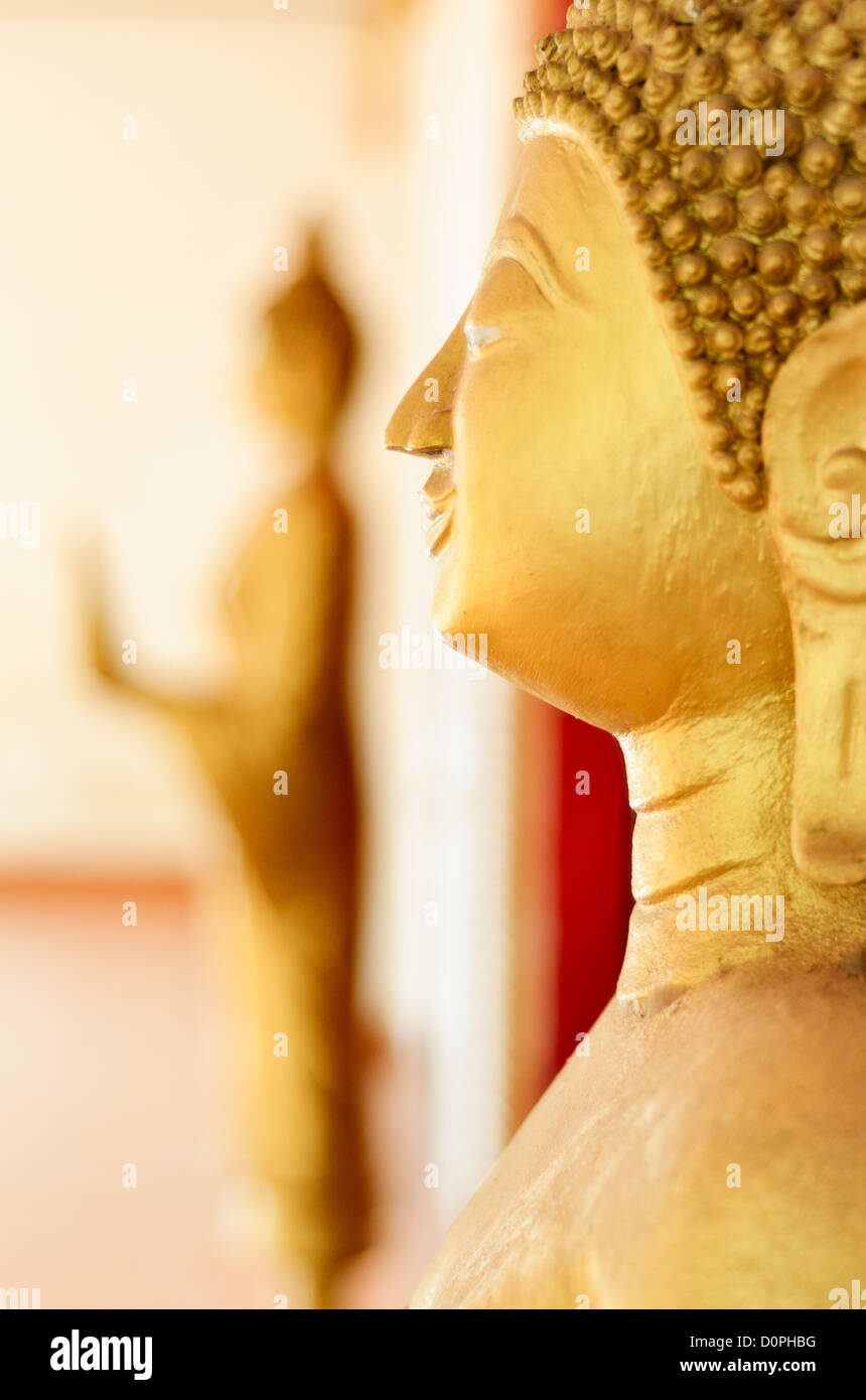 VIENTIANE, Laos - Golden statues of The Buddha (Siddhartha Gautama) at a Wat (Buddhist Temple) in Vientiane, Laos. - Stock Image