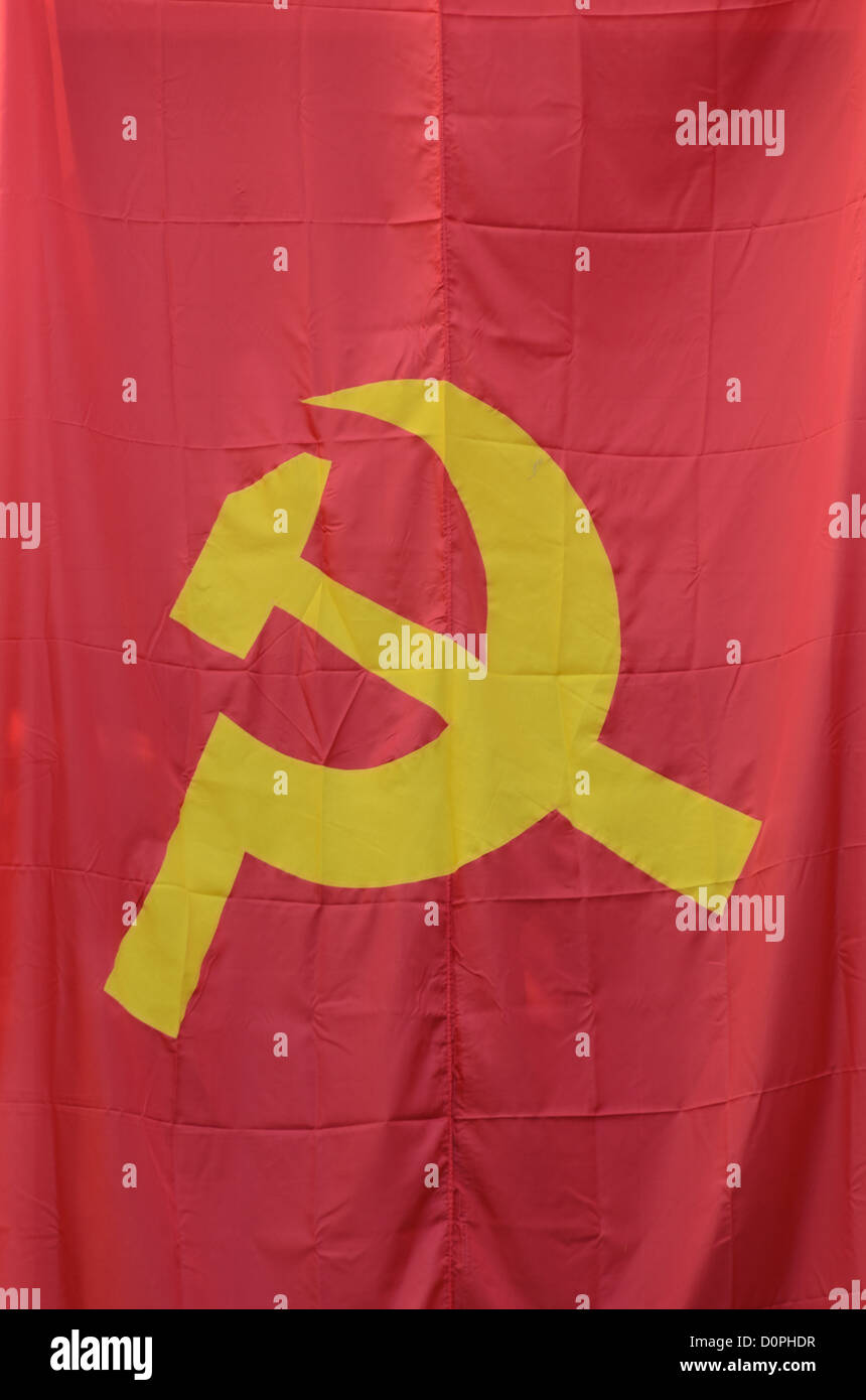 VIENTIANE, Laos - A hammer and sickle, the flag of international communism. The hammer is symbolic of the industrial - Stock Image