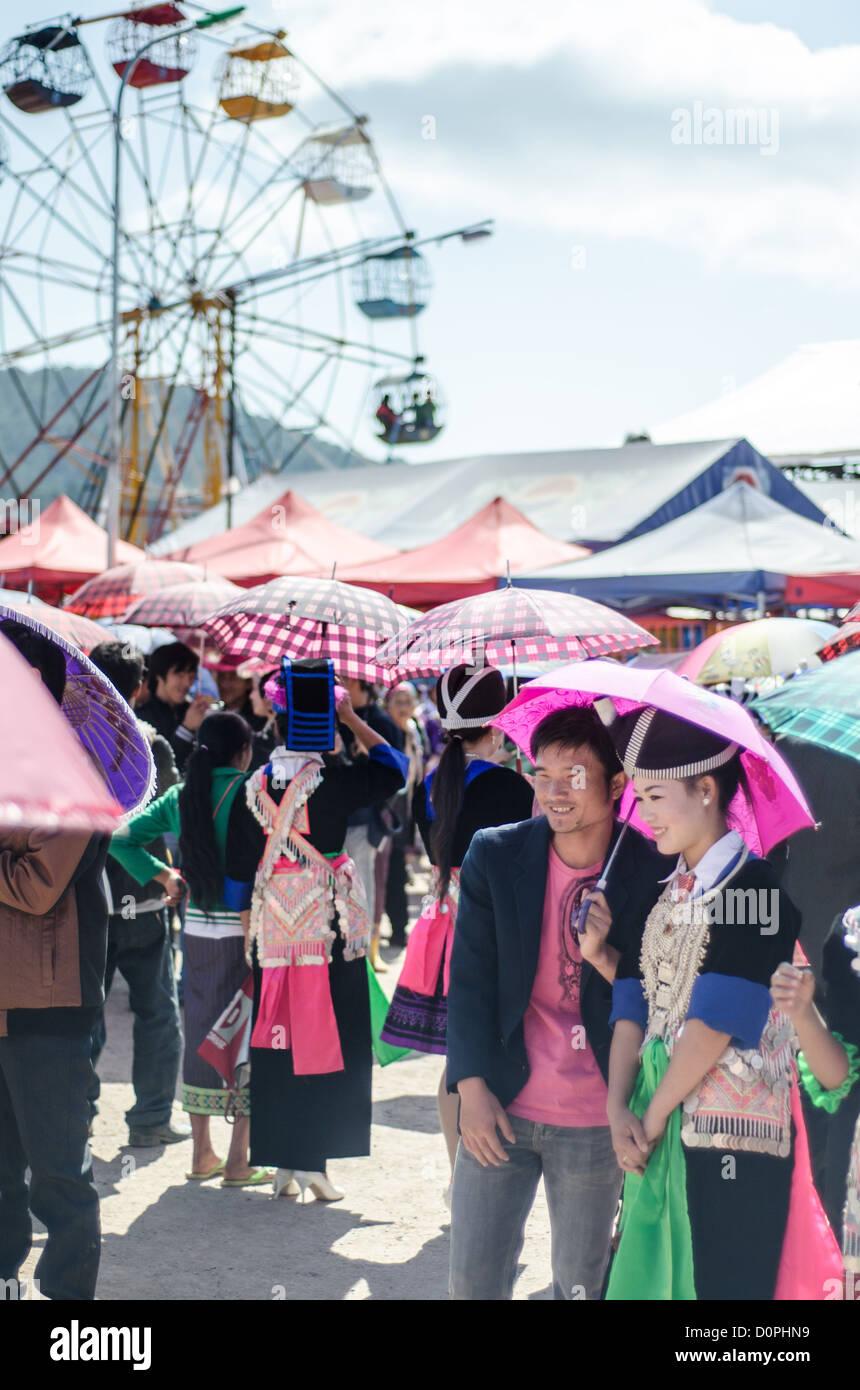 PHONSAVAN, Laos - Young Hmong men and women flock to the New Year festival in in Phonsavan in northeastern Laos. - Stock Image