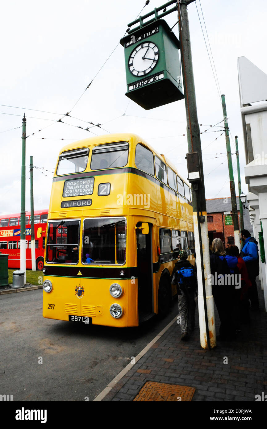 Boarding a double decker bus at the Black Country Living Museum. - Stock Image