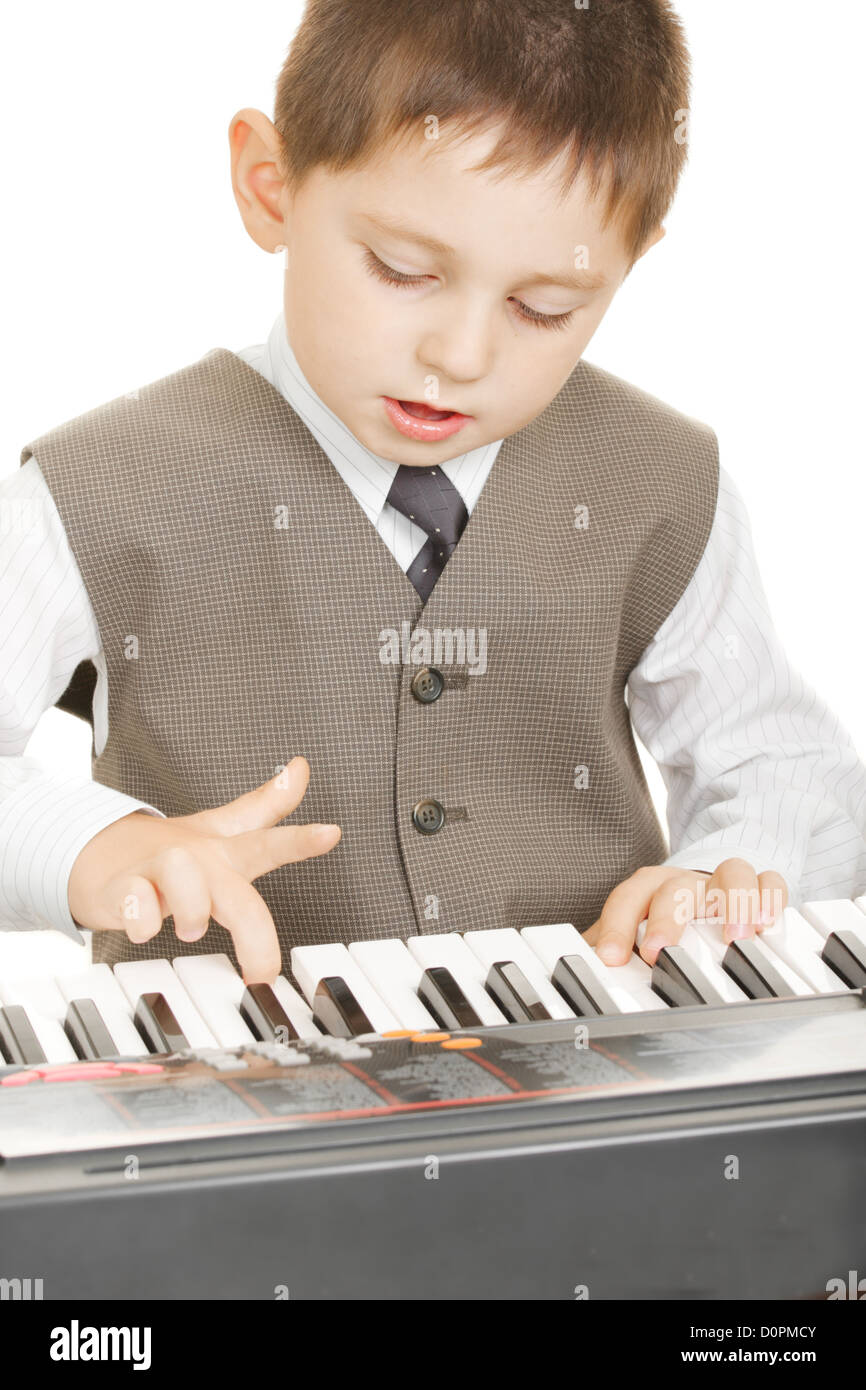 Boy playing electric piano - Stock Image