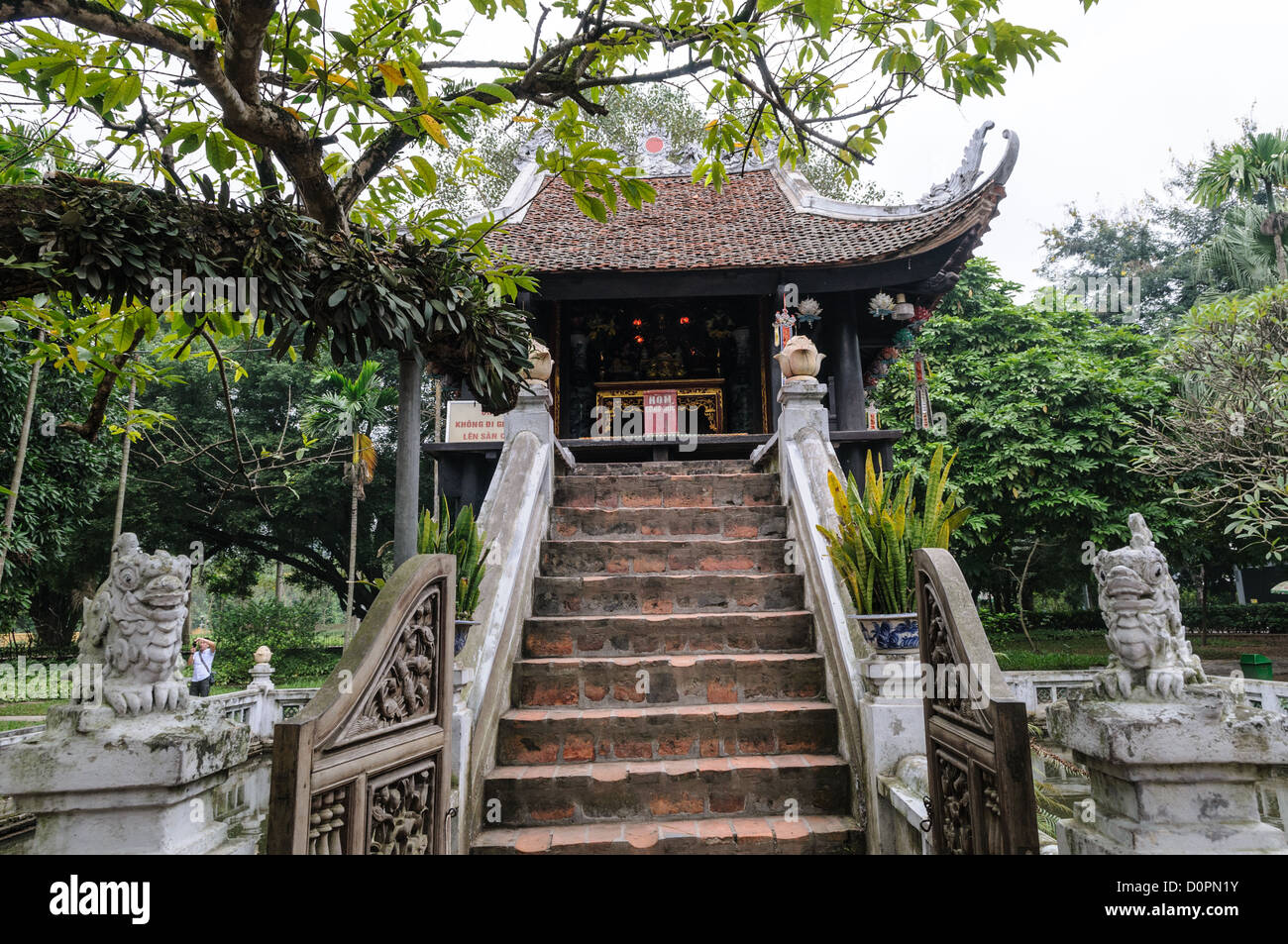 HANOI, Vietnam - The historic, small One Pillar Pagoda sits in the center of a small pond near the Ho Chi Minh Museum - Stock Image
