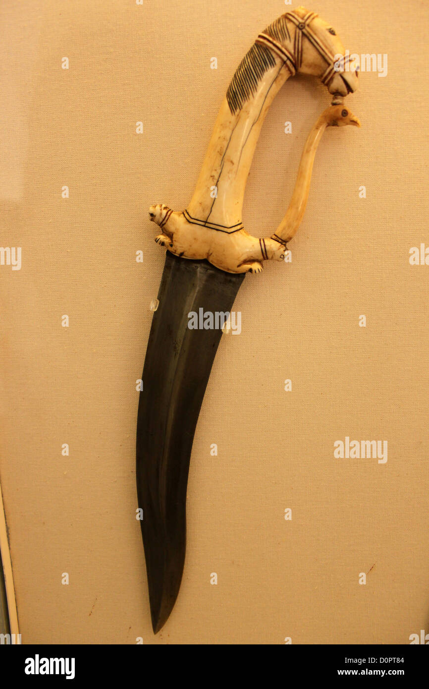 Mughal dagger with ivory handle with horse head, royal knife, Rjasthan India - Stock Image