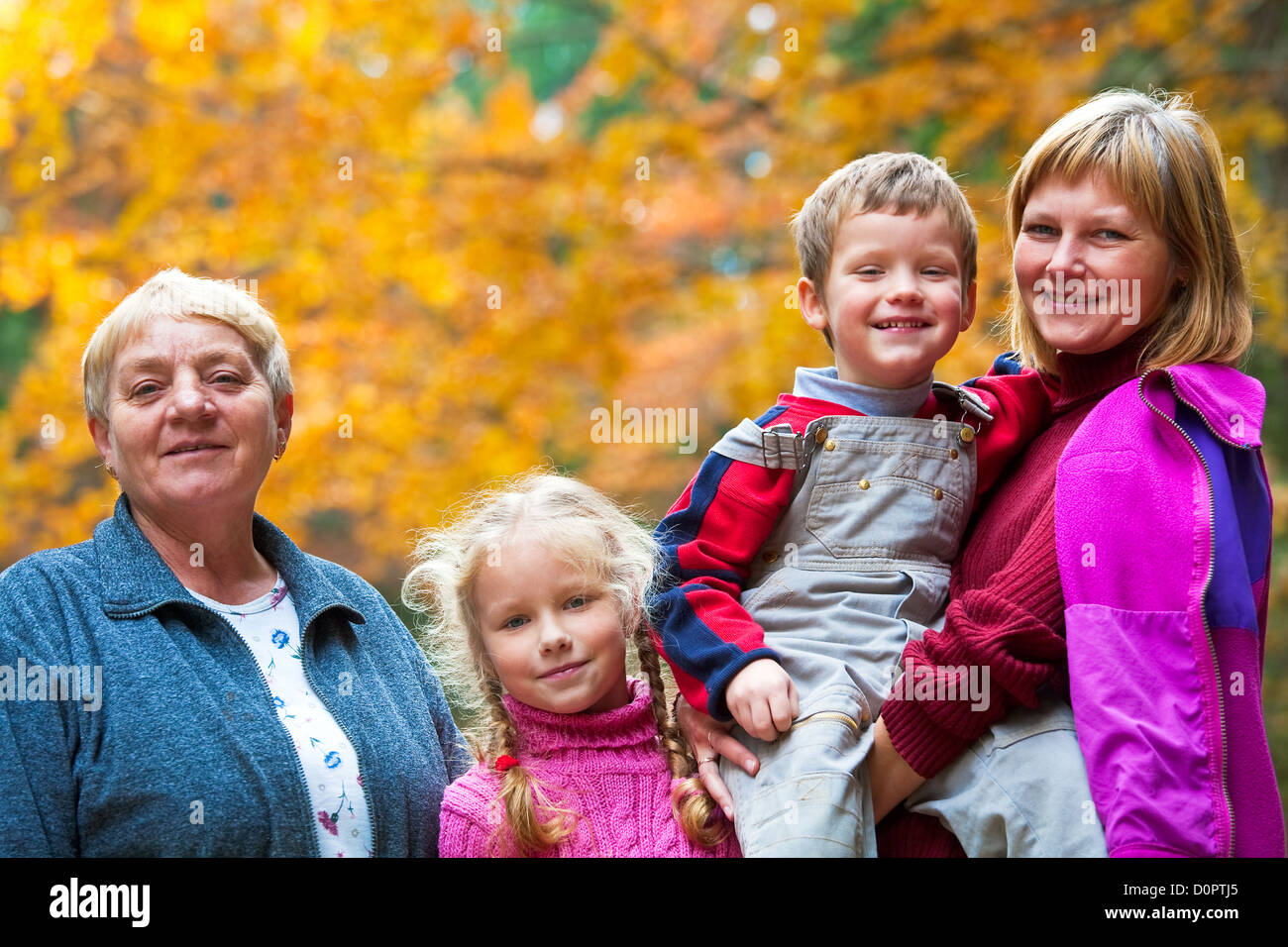 Happy family autumn outdoor portrait - Stock Image