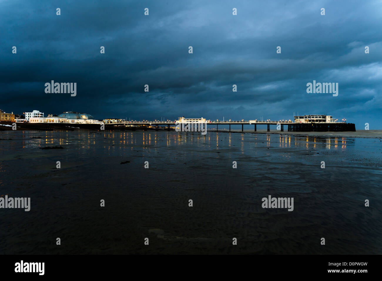 Worthing pier, West Sussex,  on a stormy evening. - Stock Image