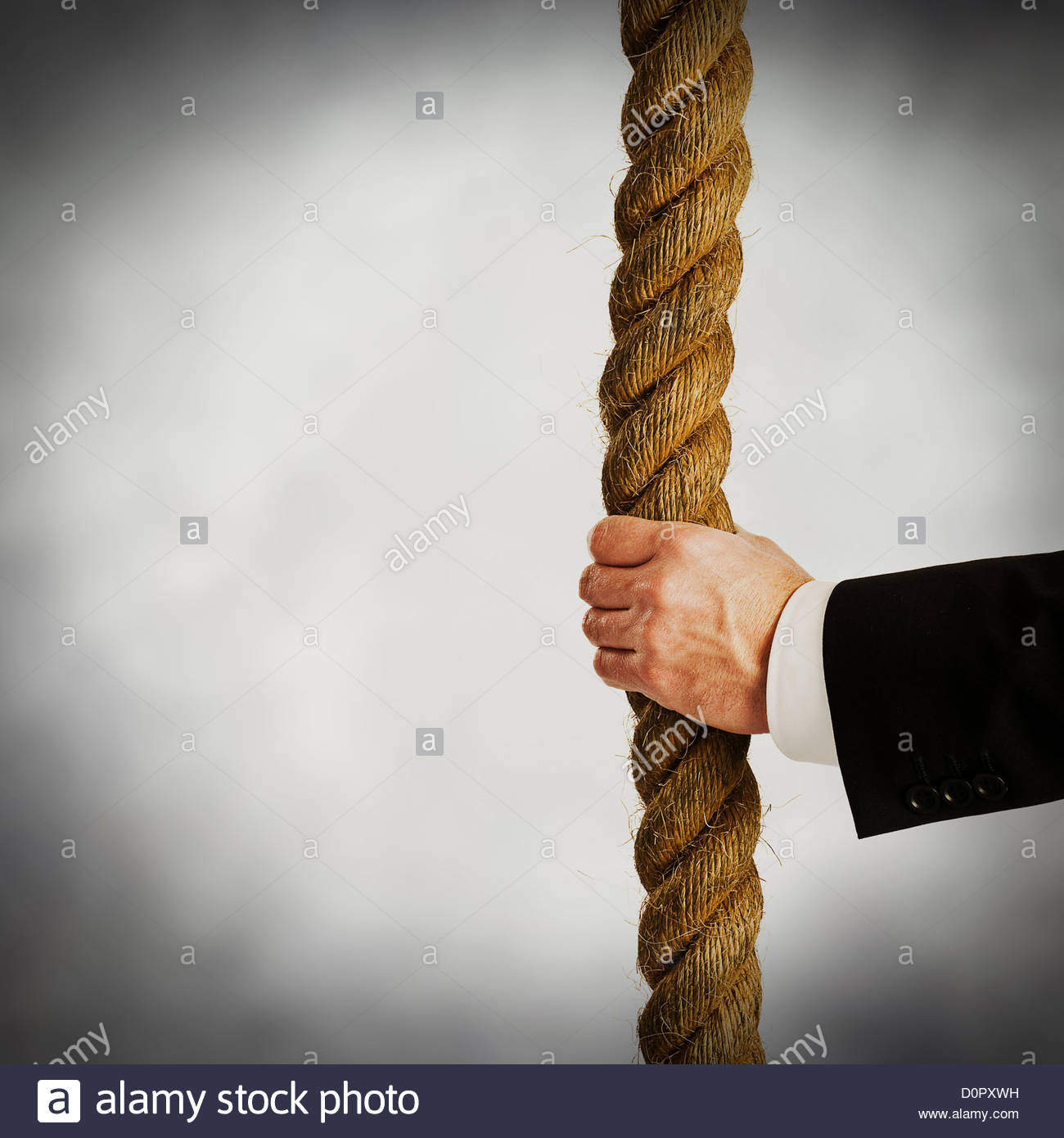 hold on to rope - Stock Image