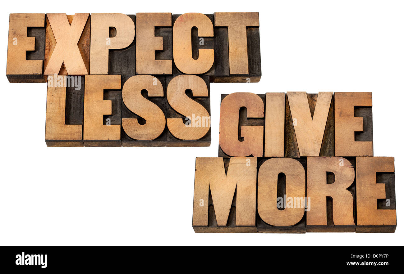 expect less, give more - motivation or self improvement concept - isolated words in vintage letterpress wood type - Stock Image