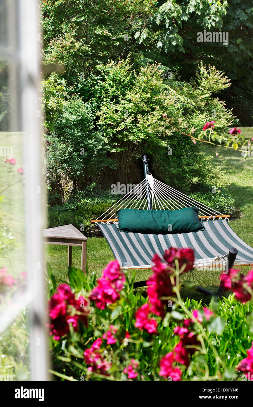 View through a window to a garden hammock - Stock Image