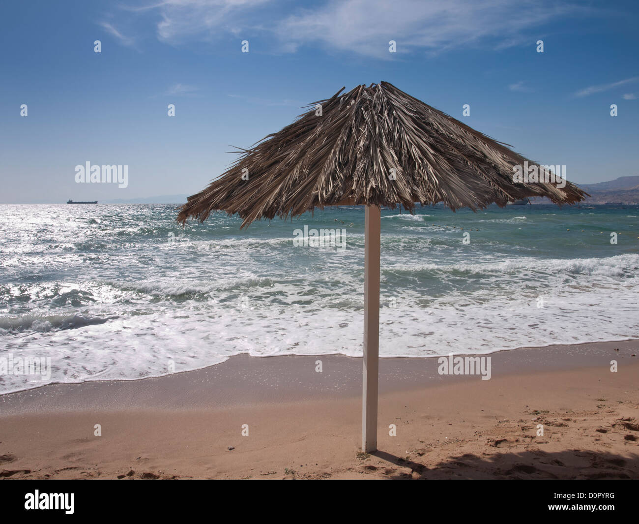 beach in Aqaba Jordan, sand and the Red Sea waves and sun - Stock Image
