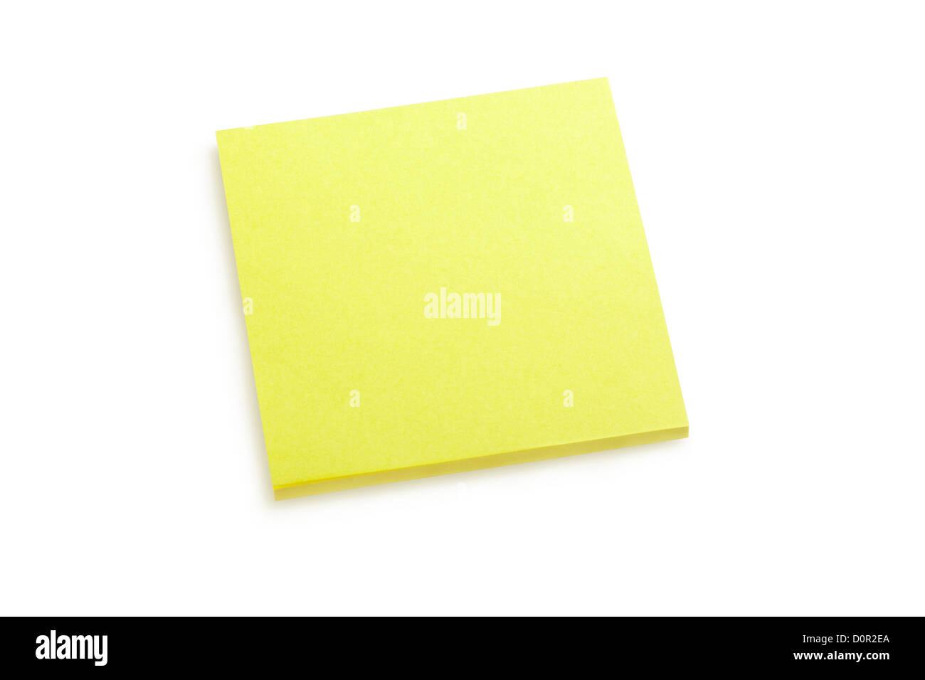 Yellow sticker note on white - Stock Image