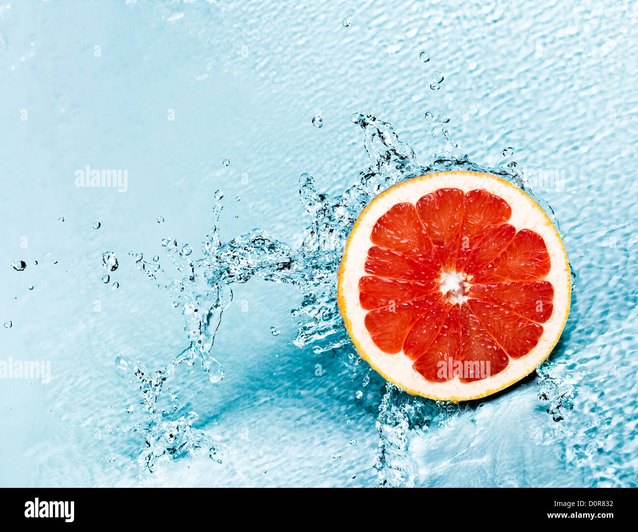 grapefruit and water - Stock Image