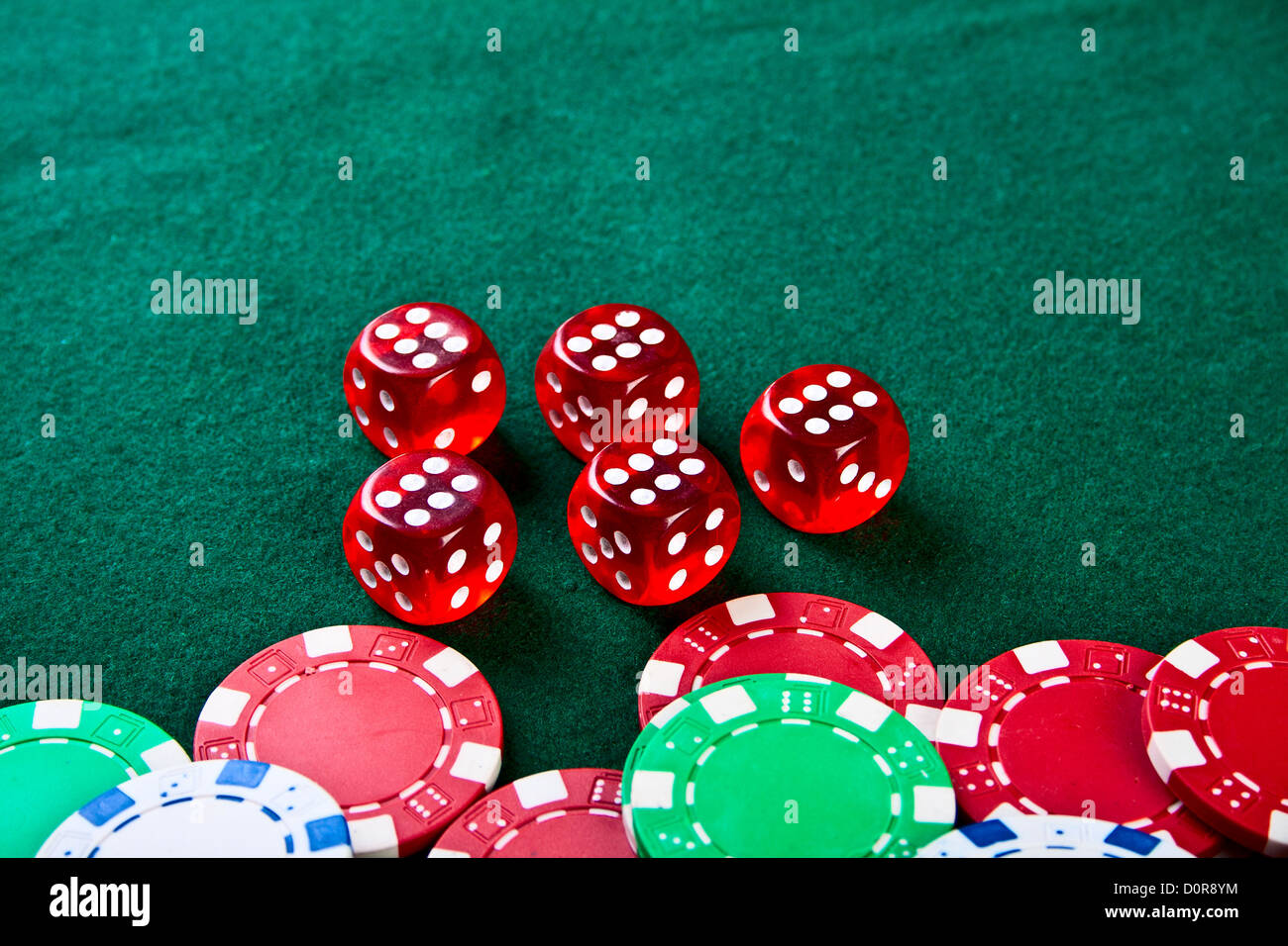 Chips and dices on the table. Stock Photo