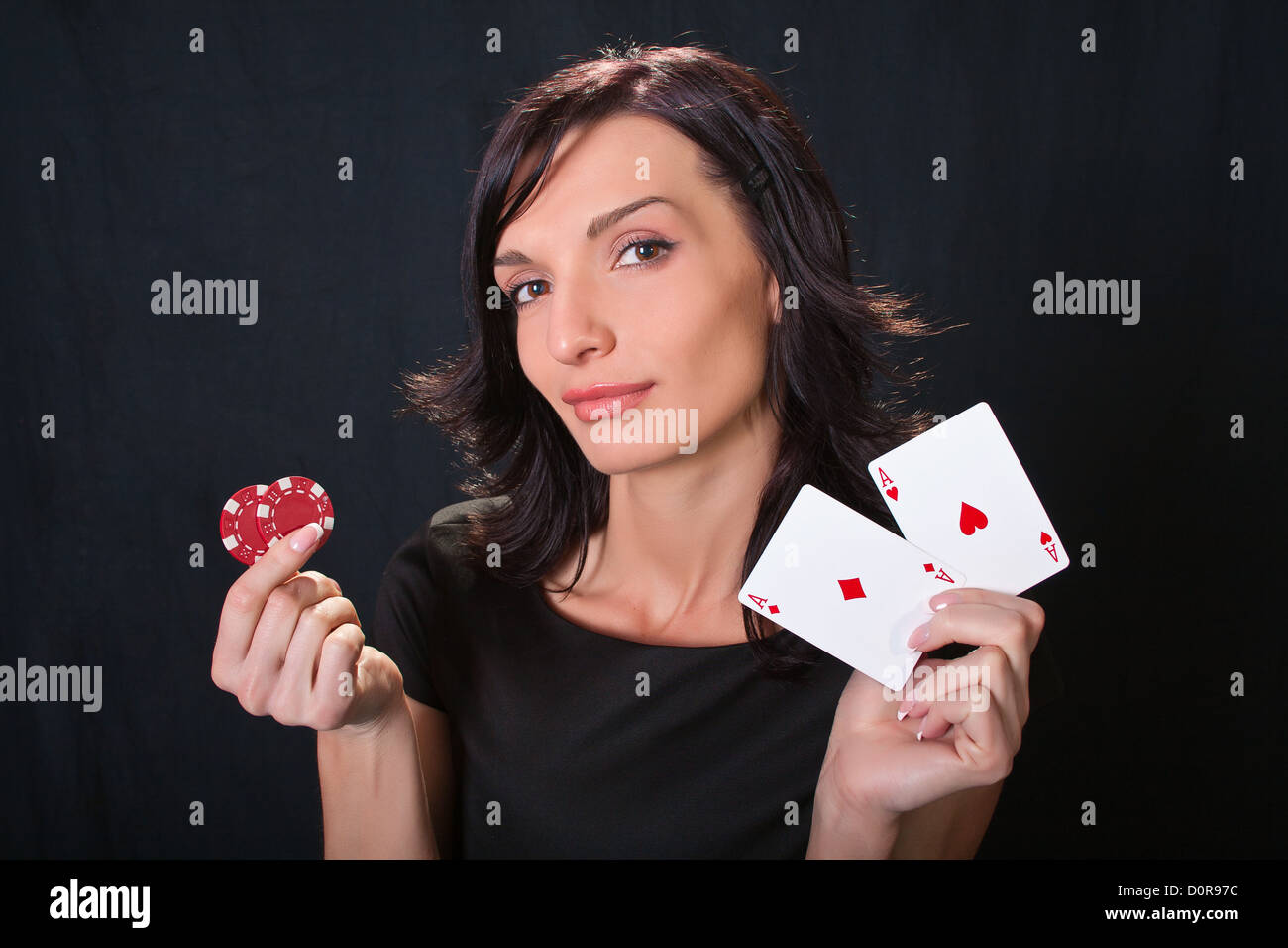 Gambler with cards and chips. - Stock Image