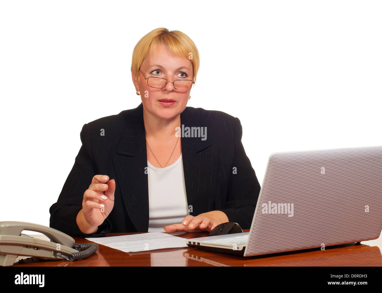 Mature businesswoman decides on the job - Stock Image