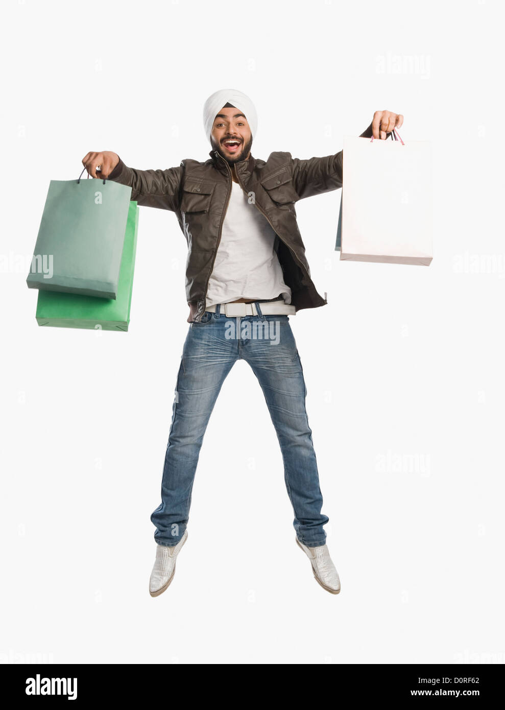 Man jumping with shopping bags - Stock Image