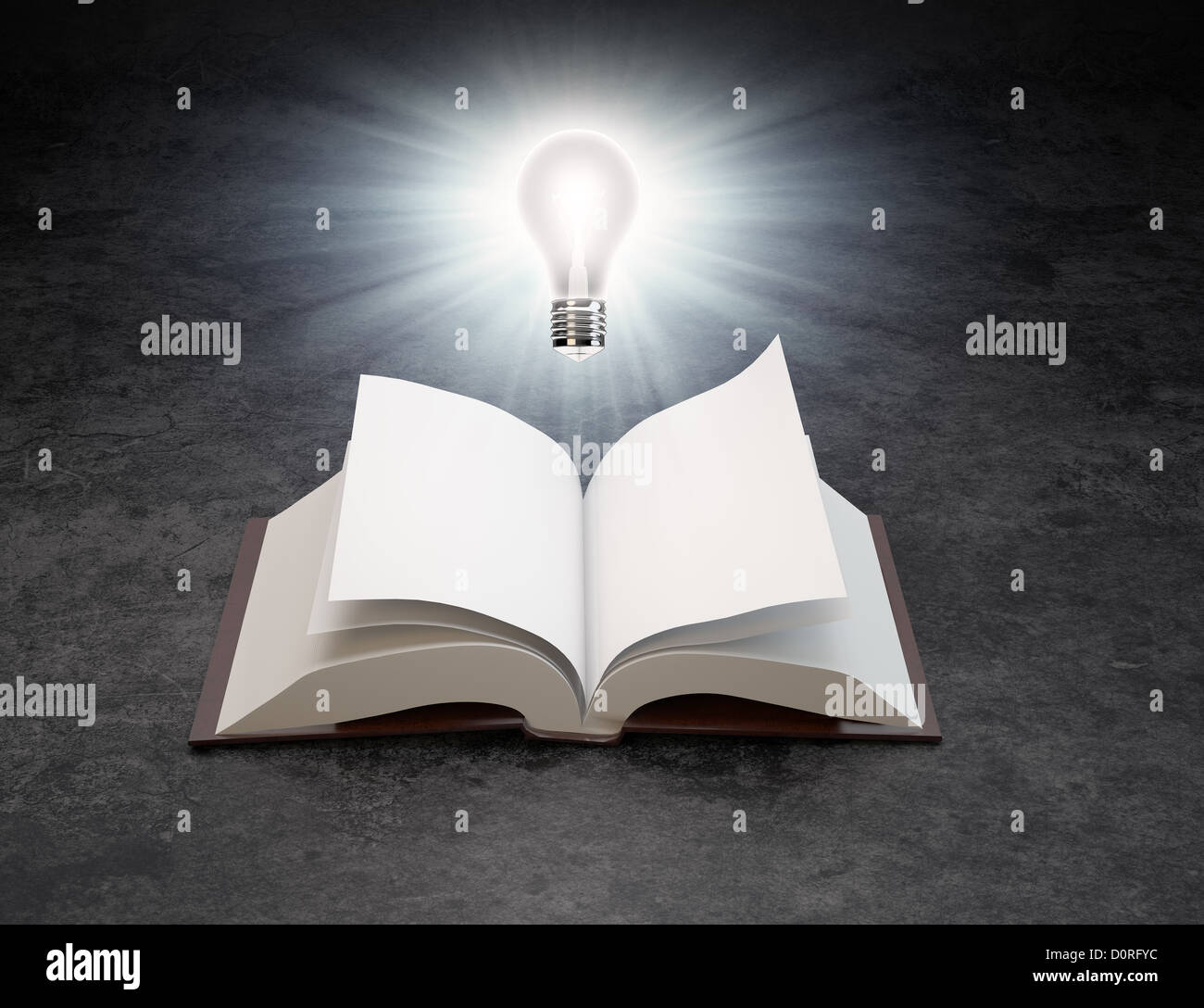 A light bulb over an open book - Stock Image