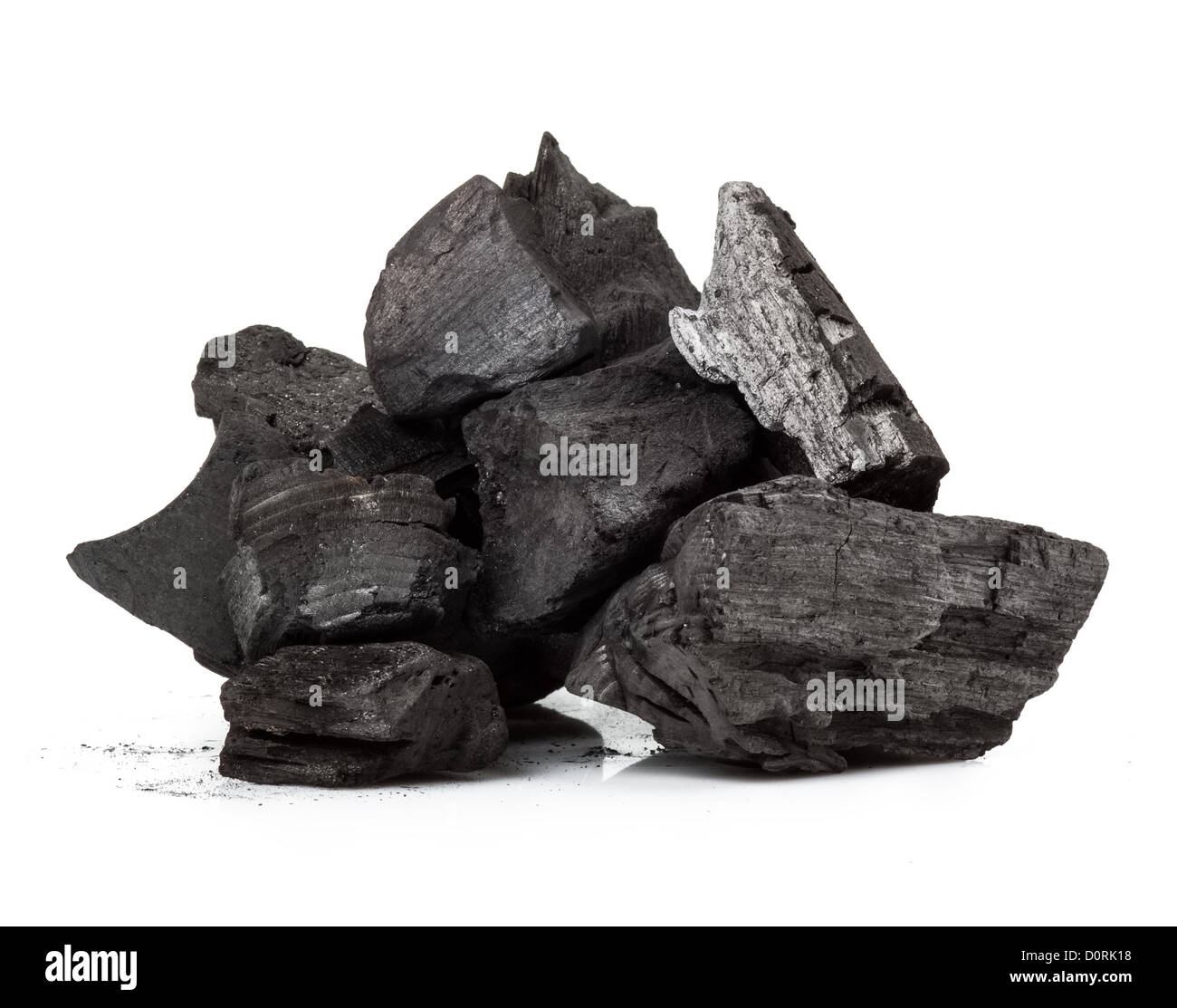 Piece of fractured wood coal isolated over white background - Stock Image