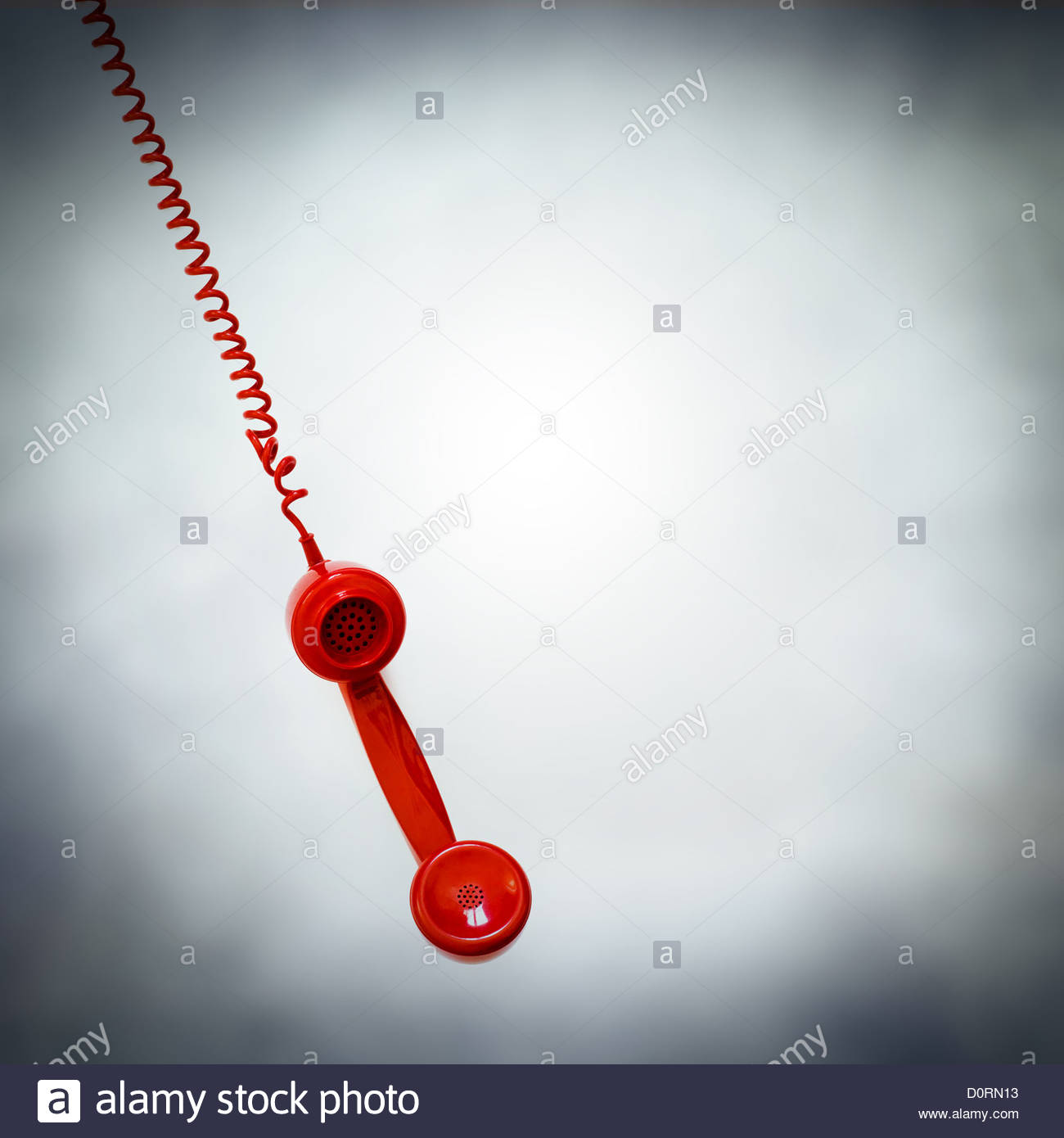 red phone hanging - Stock Image