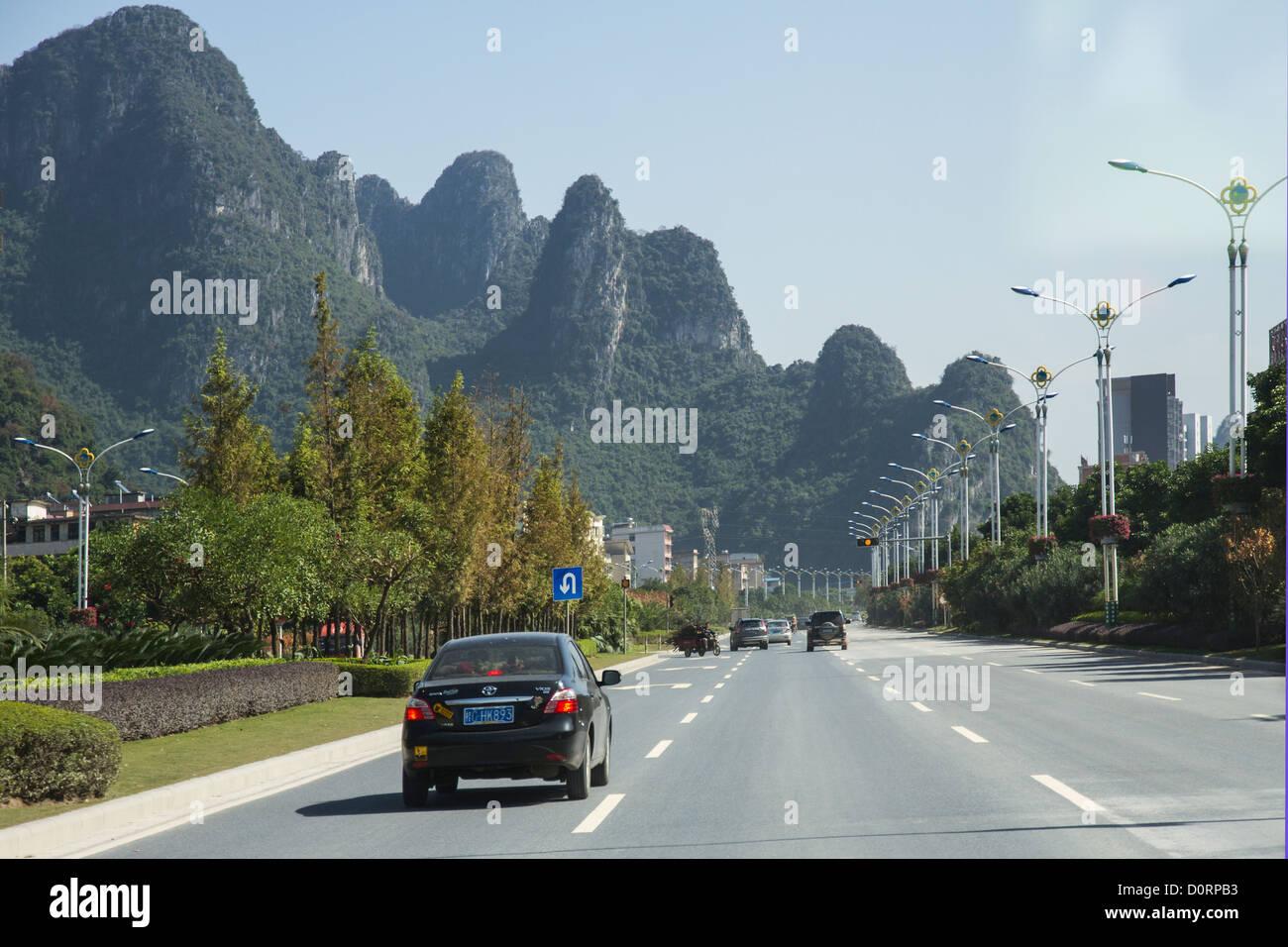 China Guangxi Guilin, road & karst mountains Stock Photo