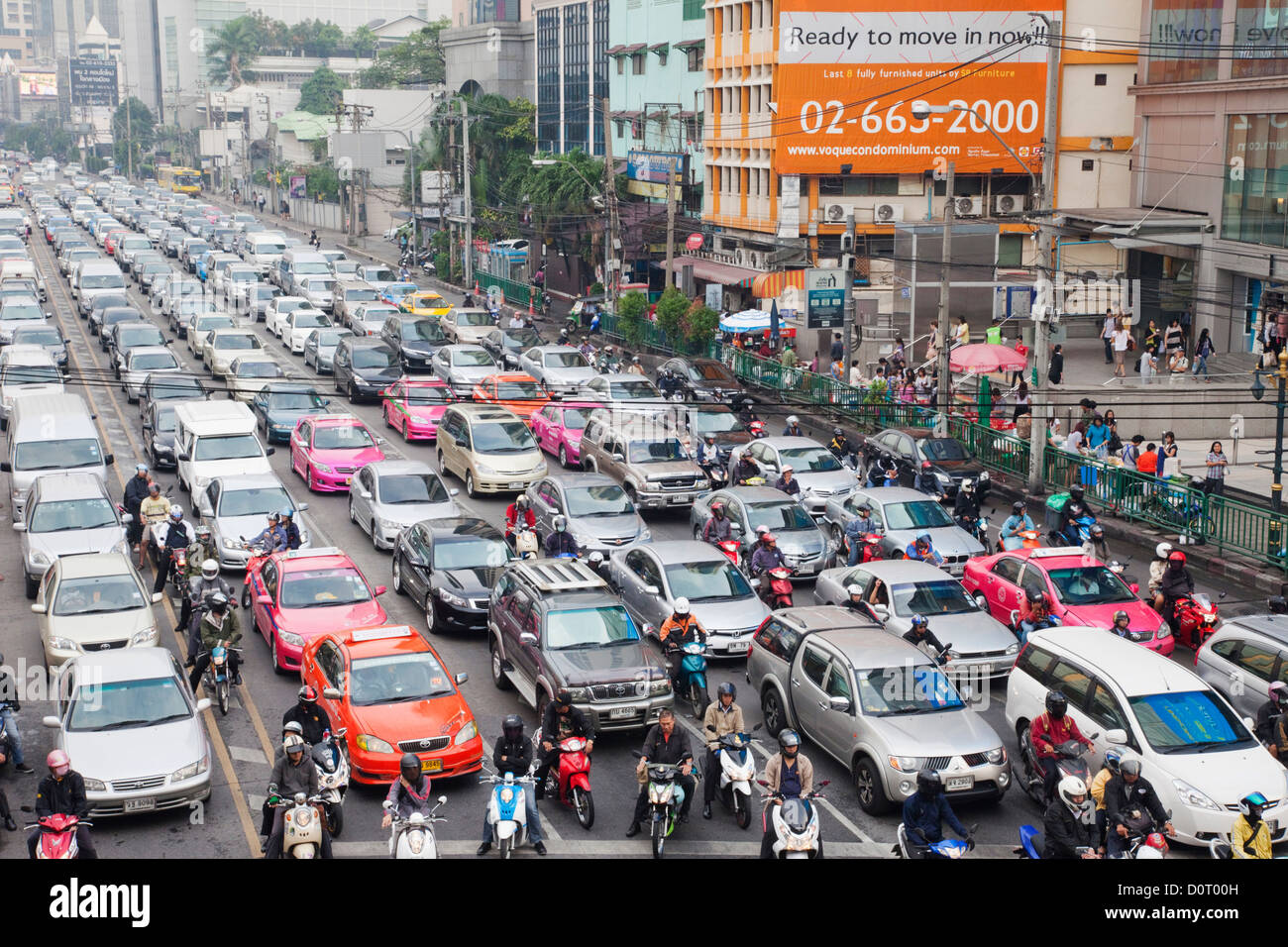 Asia Thailand Bangkok Traffic Jam Traffic Traffic Gridlock Congestion Road Roads Car Cars Taxi Taxis Motor Scooter - Stock Image