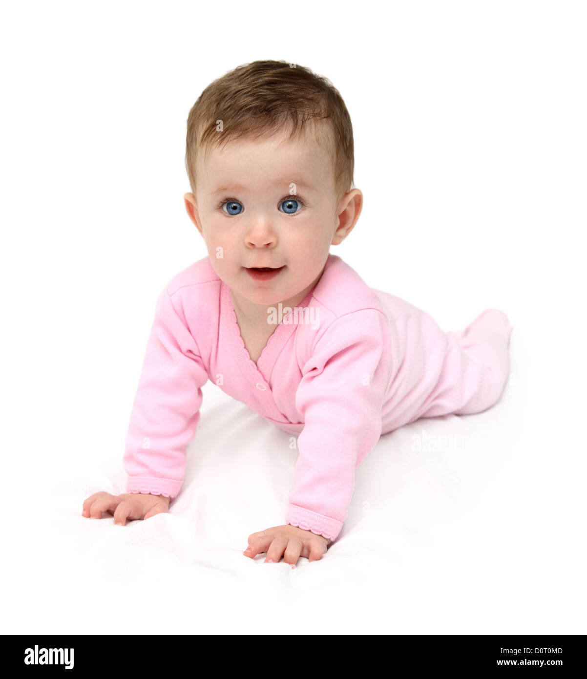 baby in pink on white sheet - Stock Image