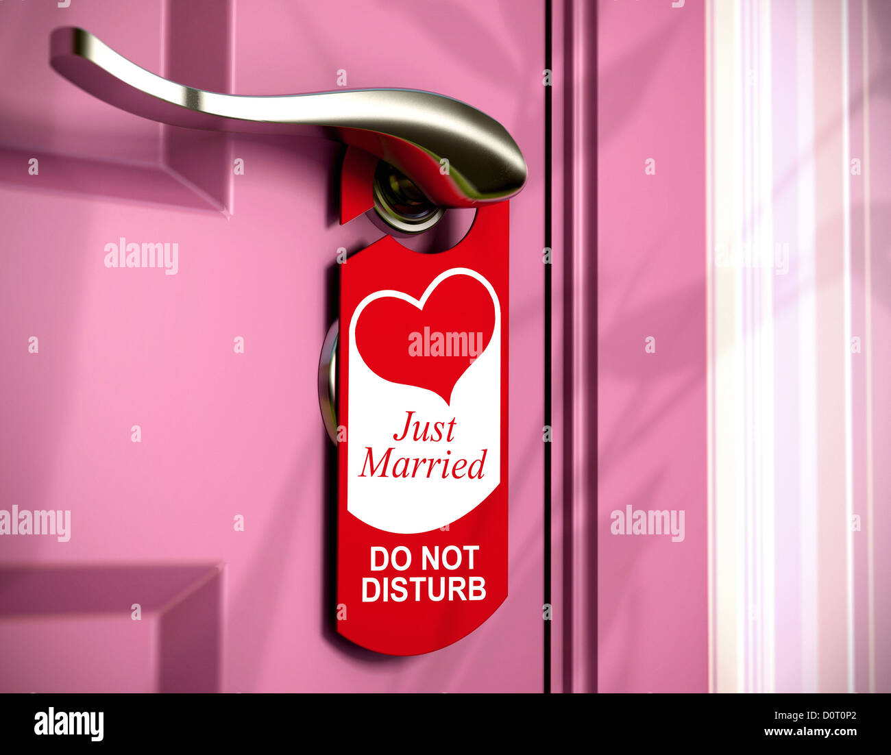 just married written onto a red door hanger, hanged on a metal handle of a pink bedroom door, concept of honeymoon. Stock Photo