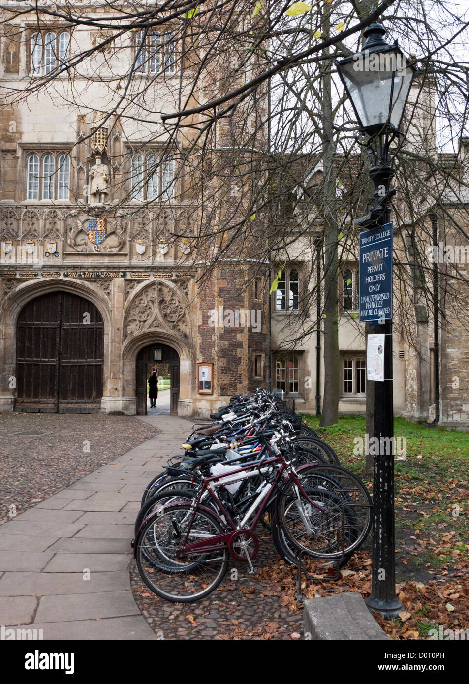 An entrance to Trinity College, Cambridge with bicycles parked in the foreground. - Stock Image