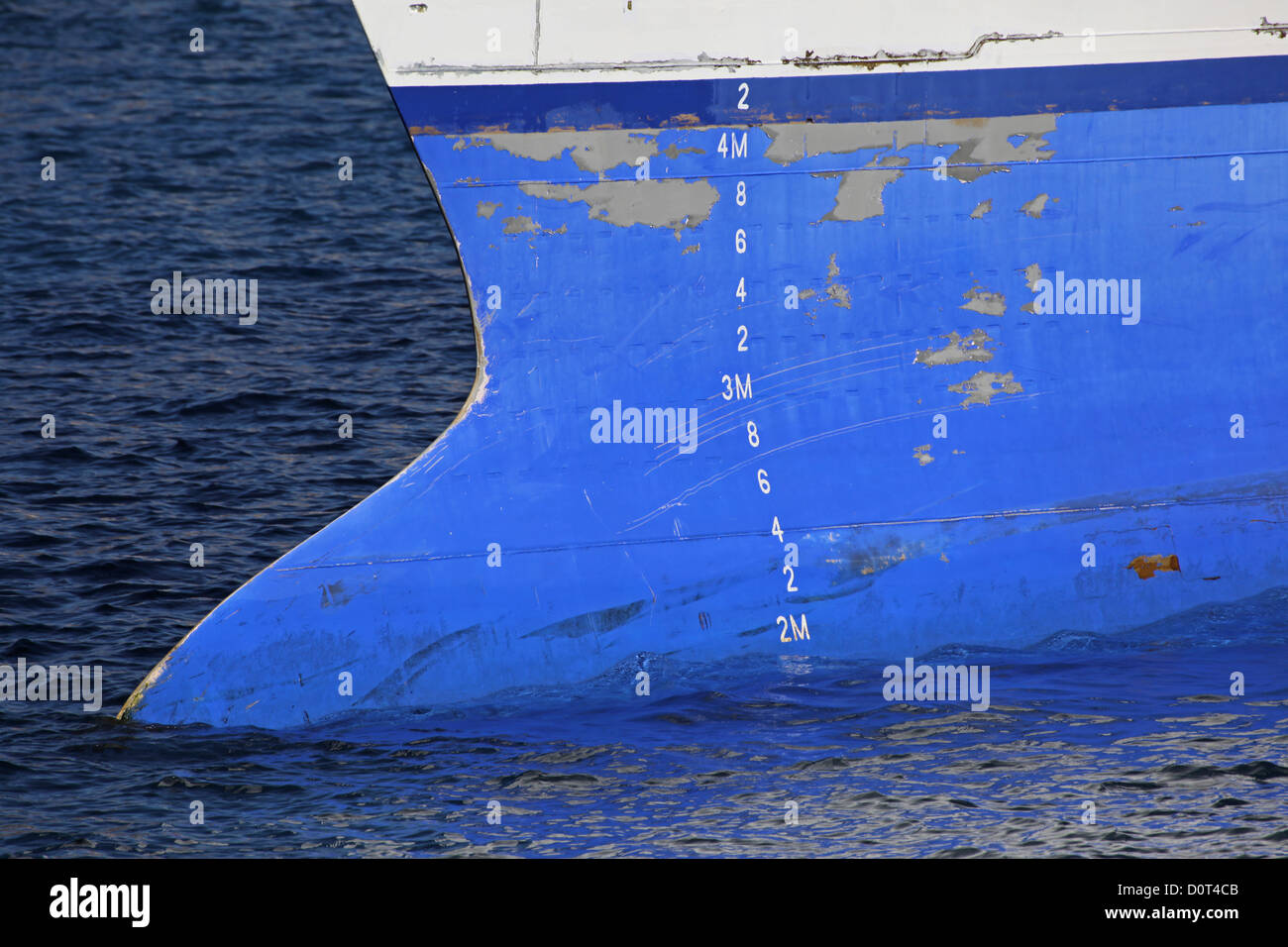 Close-up of the sharp keel with scratches of a high-speed ferry - Stock Image