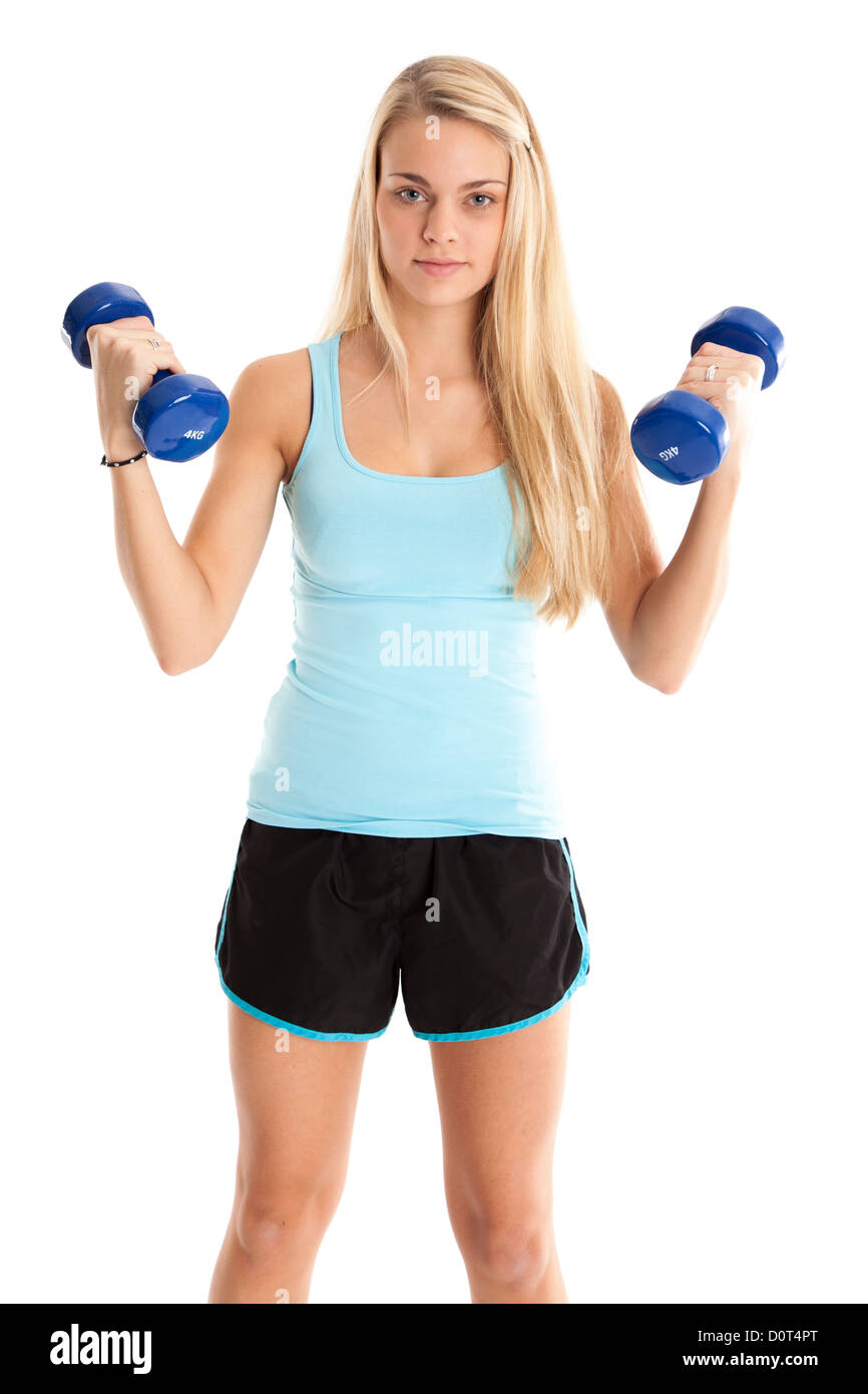 Pretty young woman with dumbbells. - Stock Image