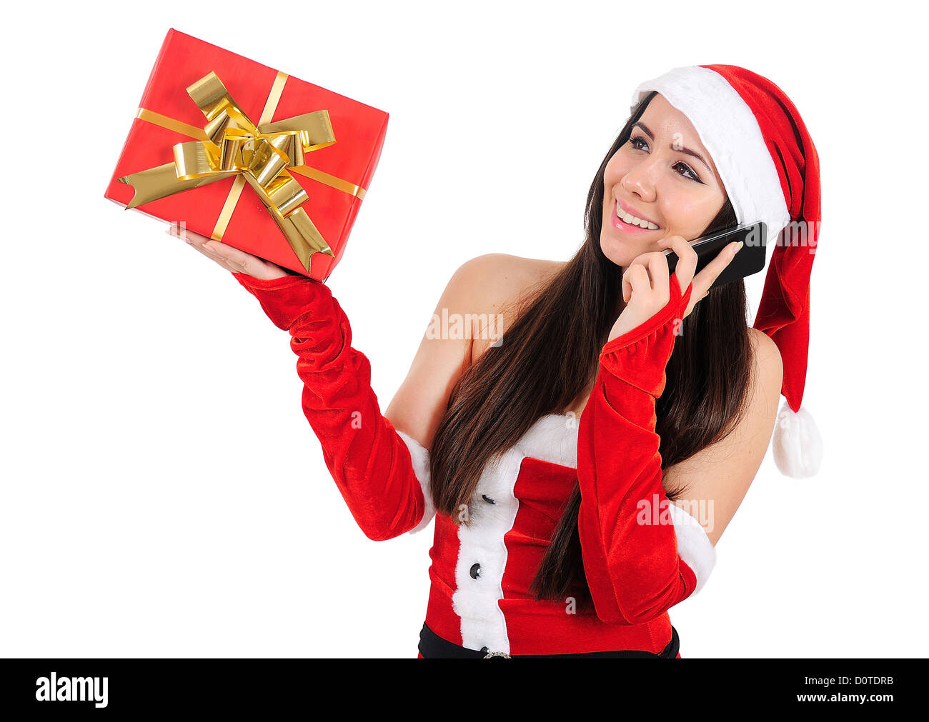 Isolated Young Christmas Girl Speaking Phone - Stock Image