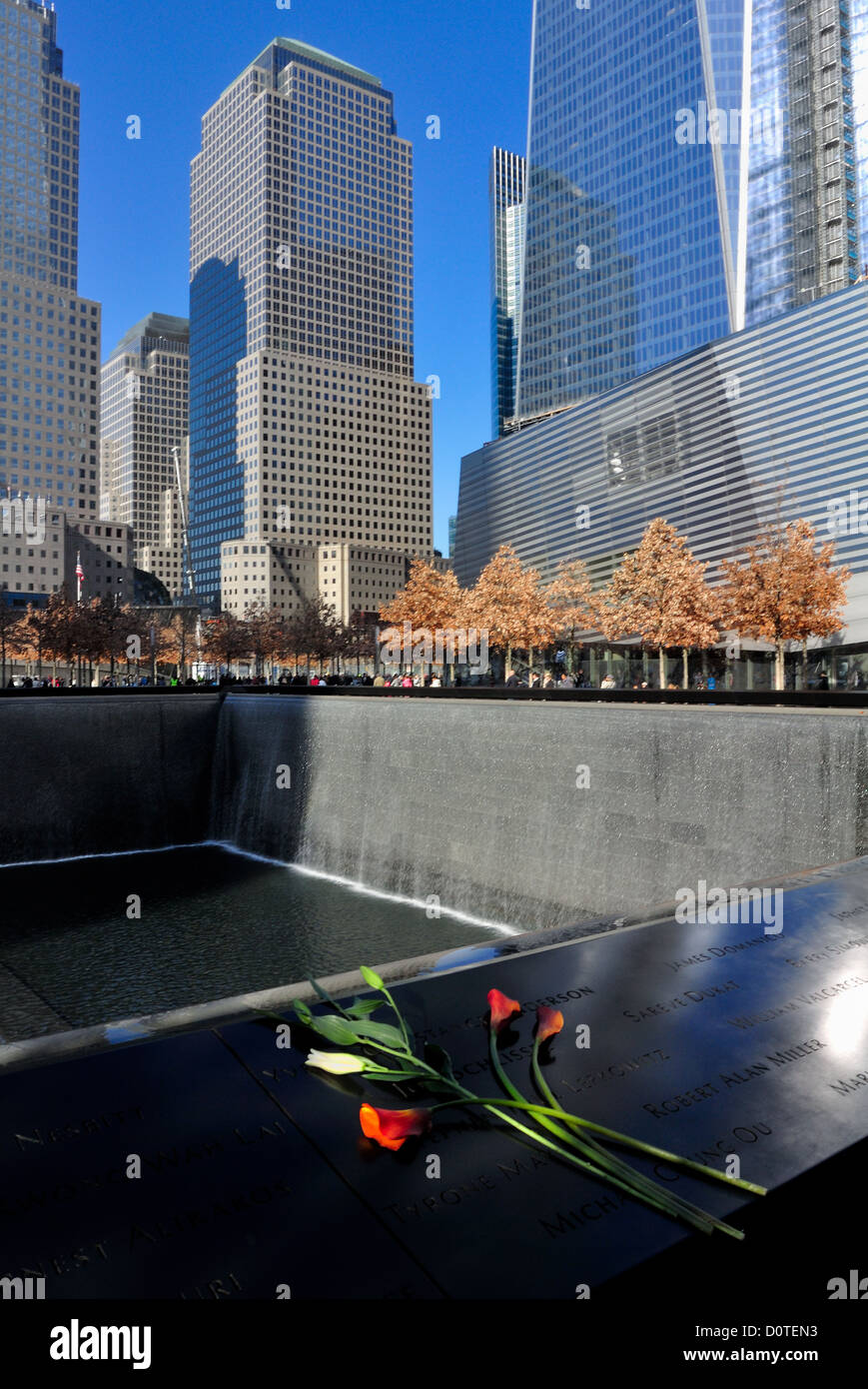 South reflecting pool and surrounding buildings, 9/11 Memorial, New York City. - Stock Image