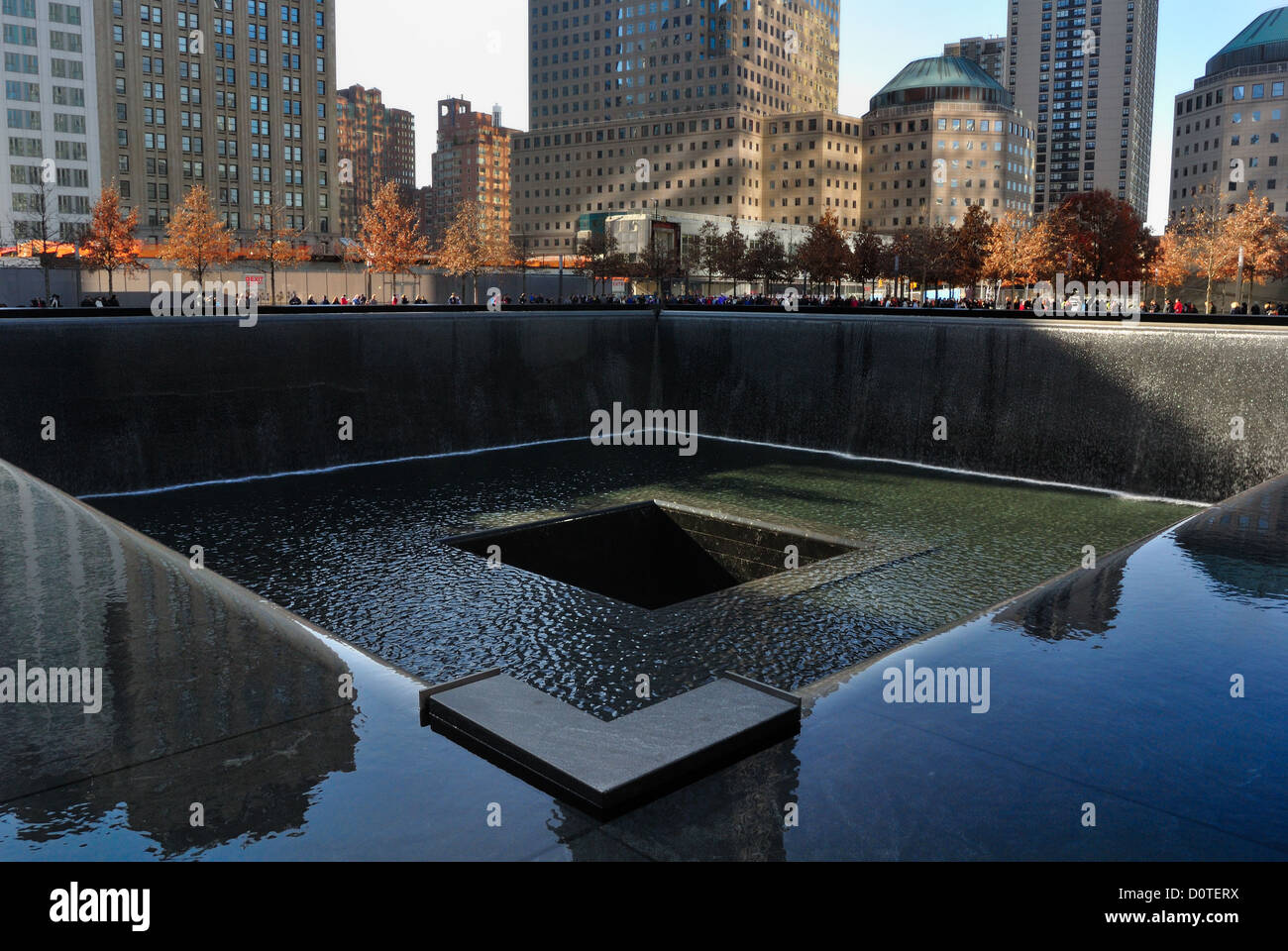 South reflecting pool and surrounding buildings, 9/11 Memorial, New York City.. - Stock Image