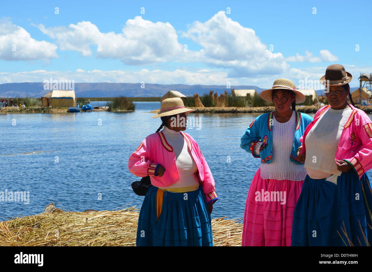 Ladies of the Uros Islands, Lake Titicaca, Puno, Peru. - Stock Image
