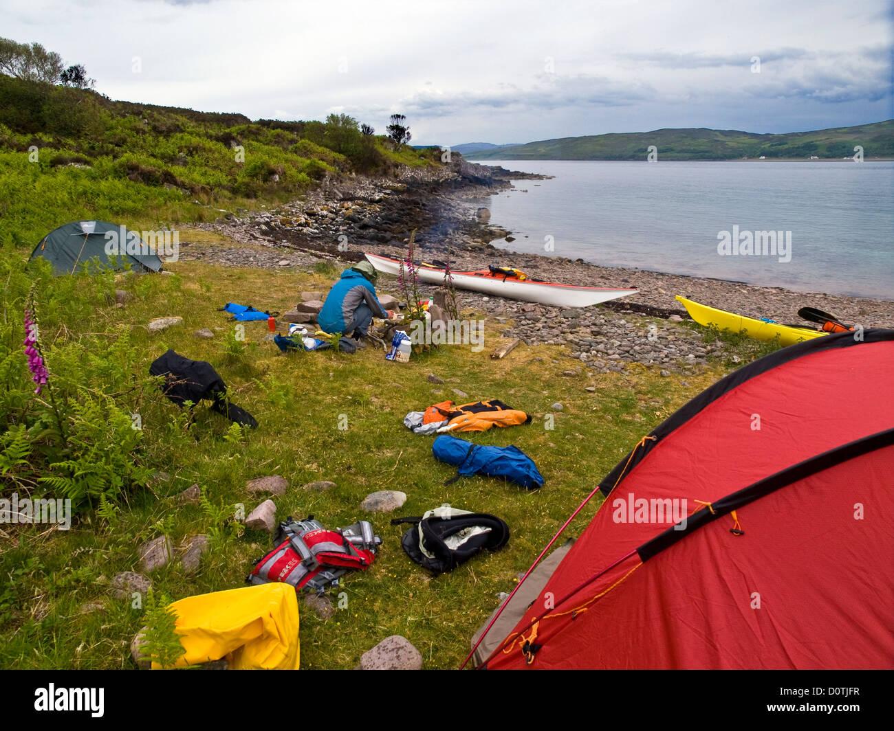 Sea kayaker Wild camping on the beach on Scalpay on Scotland's west coast - Stock Image