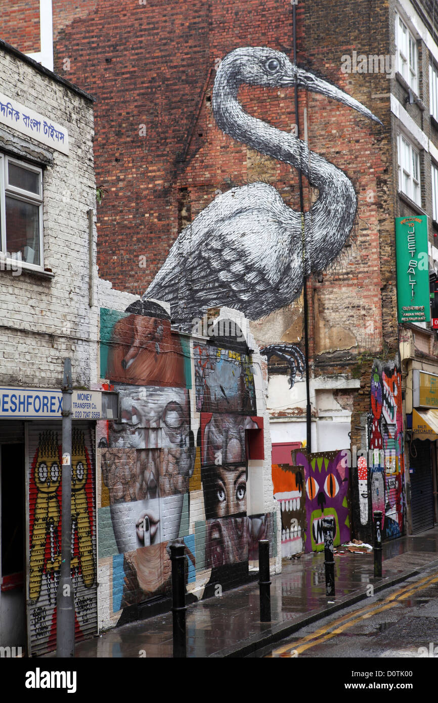 Graffiti and urban art off Brick Lane, London, England. The area in London's E1 district is becoming known as Banglatown. Stock Photo