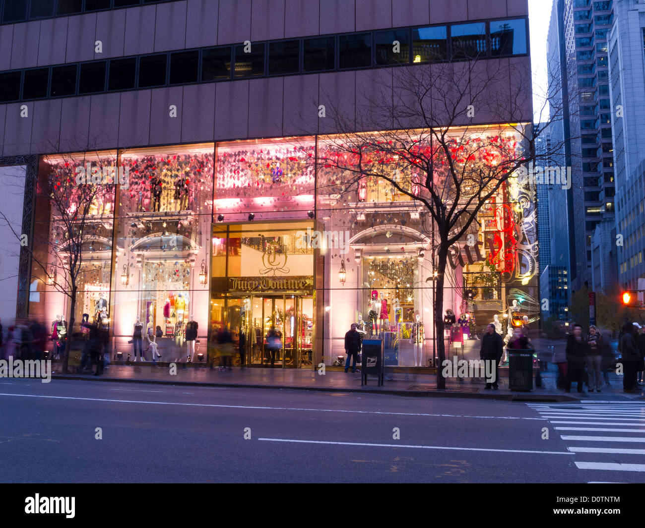 Juicy Couture Store at Dusk with Holiday Seasonal Decorations, Fifth Avenue, NYC - Stock Image