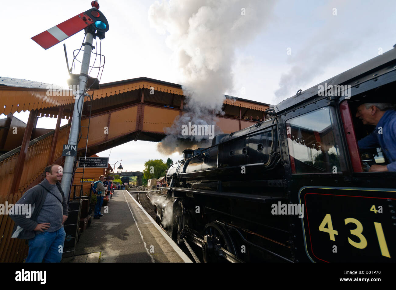 Ivatt class 4 number 43106 Steam Locomotive on the West Somerset Railway pulling away from Williton station. Stock Photo