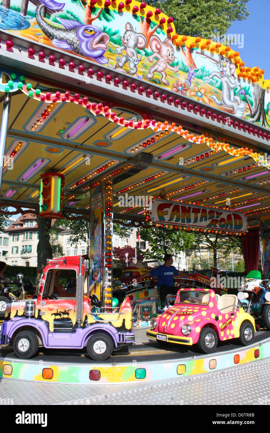 Colourful cars in fun fare in Zug, Switzerland Stock Photo