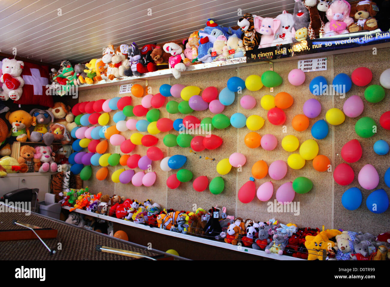 Colourful balloons and soft toys in fun fair in Zug, Switzerland Stock Photo