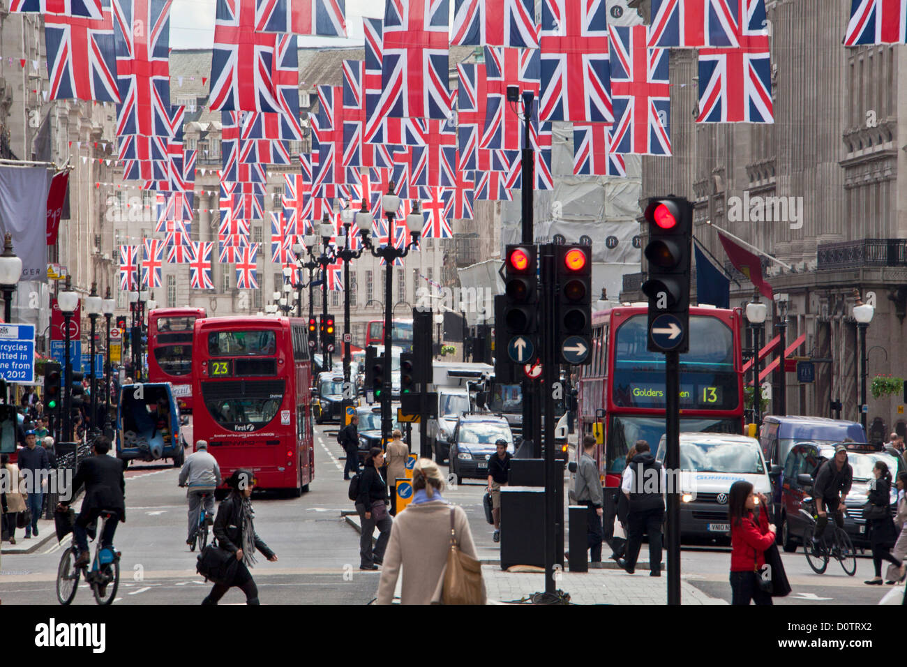 UK, Great Britain, Europe, travel, holiday, England, London, City, Oxford Street, buses, flags, red, traffic - Stock Image