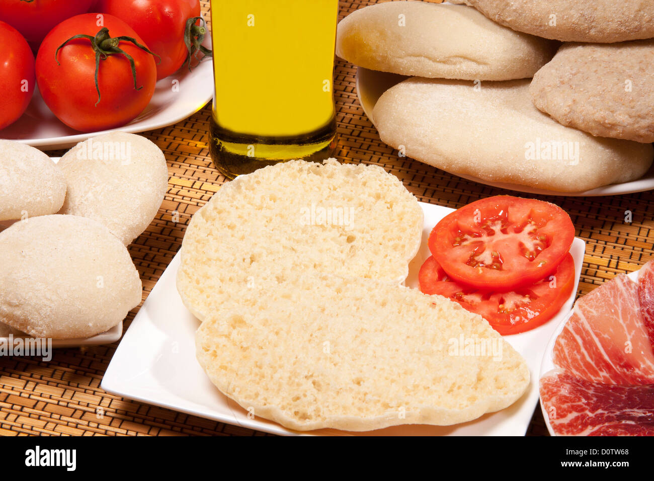 Breakfast muffin with extra virgin olive oil and ham tomato Antequera Andalusia Spain - Stock Image